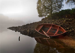 Rowing Boat Reflections on misty morning in Glen Affric